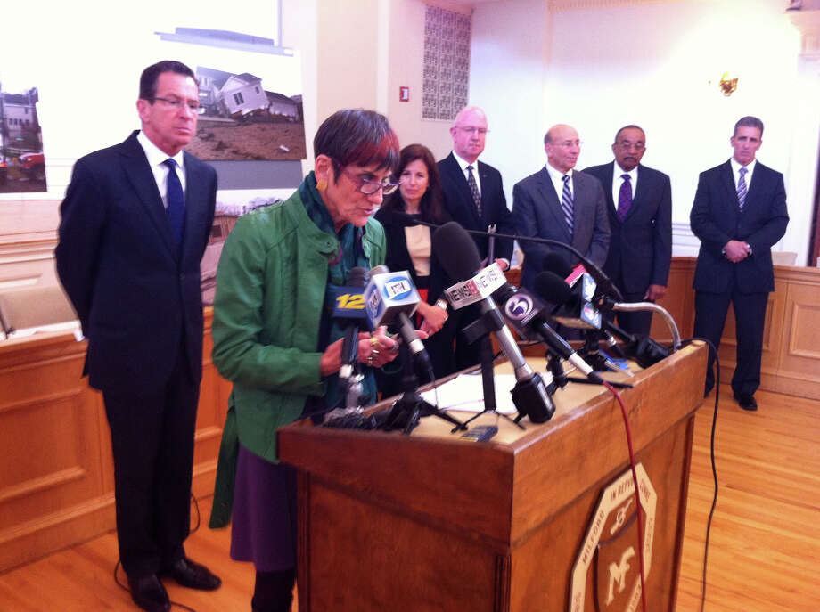 U.S. Rep. Rosa DeLauro on Monday said that Republicans in Congress held up Sandy aid for nearly three months while storm-tossed families suffered. She was speaking at a press conference in Milford City Hall  on Monday, October 28, 2013. Behind here is Gov. Dannel Malloy, State Sen. Gayle Slossberg, and other officials. Photo: John Burgeson / Connecticut Post