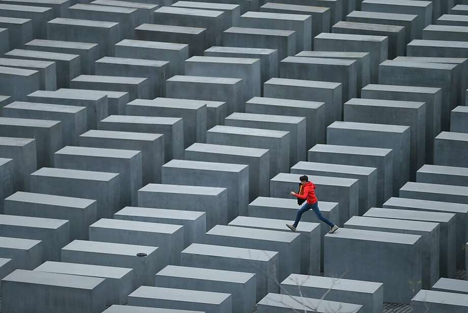 A boy hops from one stone to anotheramid the 2,711 stellae of the Memorial to the Murdered Jews of Europe, also known as the Holocaust Memorial, in Berlin. The monument, designed by American architect 