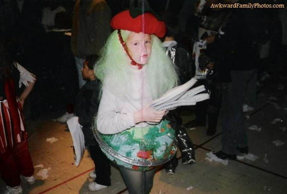 Salad girl: Notice the veggie tray skirt Photo: Awkward Family Photos