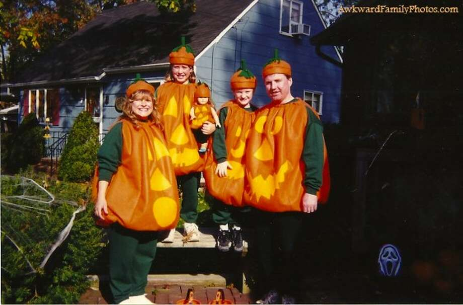 A family of pumpkins: Even dolly got to dress up Photo: Awkward Family Photos