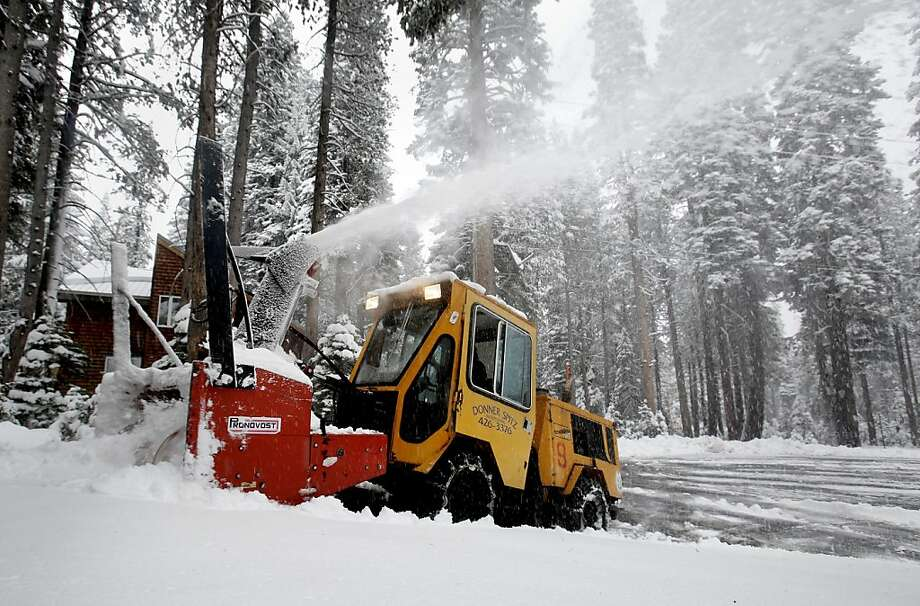 A snow blower removes snow from a driveway near Soda Springs, Calif., Monday, Oct. 28, 2013.  As much as 10 inches of snow fell in the Sierra Nevada in the Lake Tahoe area overnight in the first significant storm of the season.(AP Photo/Rich Pedroncelli Photo: Rich Pedroncelli, Associated Press