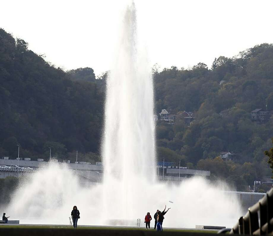 Visitors to Point State Park play in front of the fountain on Monday, Oct. 28, 2013, in Pittsburgh. The PA Department of Conservation and Natural Resources said the fountain will be turned off for winterization on Nov. 1, 2013. (AP Photo/Keith Srakocic) Photo: Keith Srakocic, Associated Press