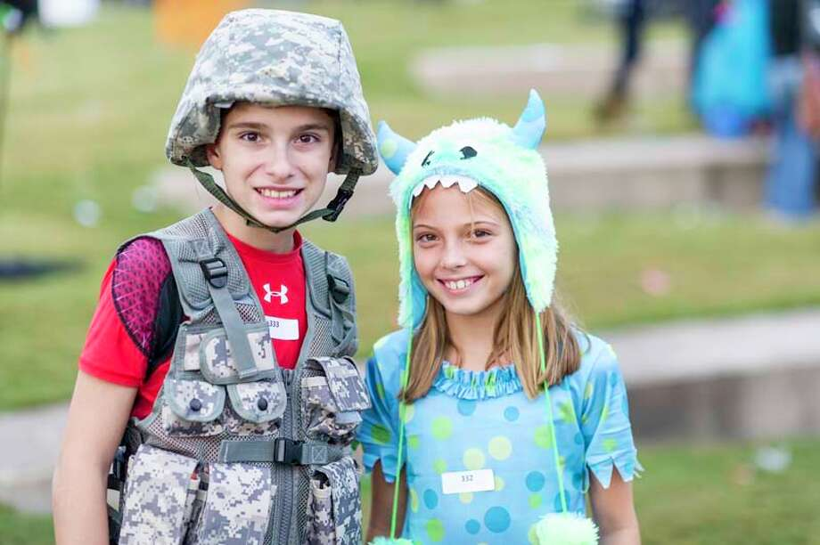 Children and families dressed up and competed for the best costume at The Woodlands Convention and Visitor's Bureau's Trick or Treat Trail event on Oct. 27. Photo: DERRICK BRYANT PHOTOGRAPHY
