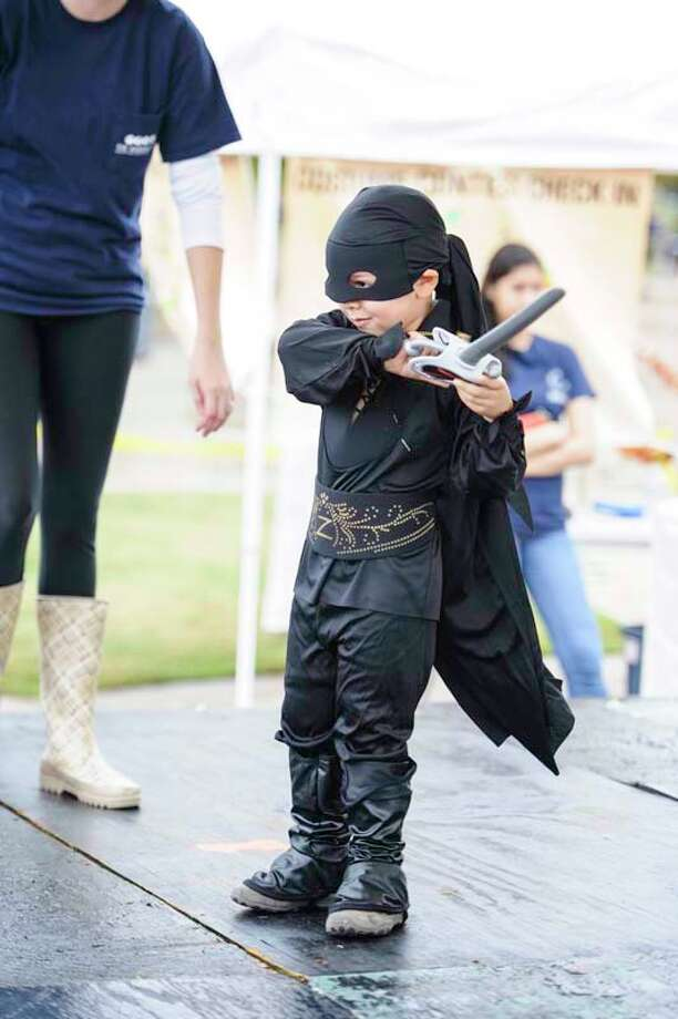Children and families dressed up and competed for the best  costume at The Woodlands Convention and Visitor's Bureau's Trick or Treat Trail event on Oct. 27. Photo: DERRICK BRYANT