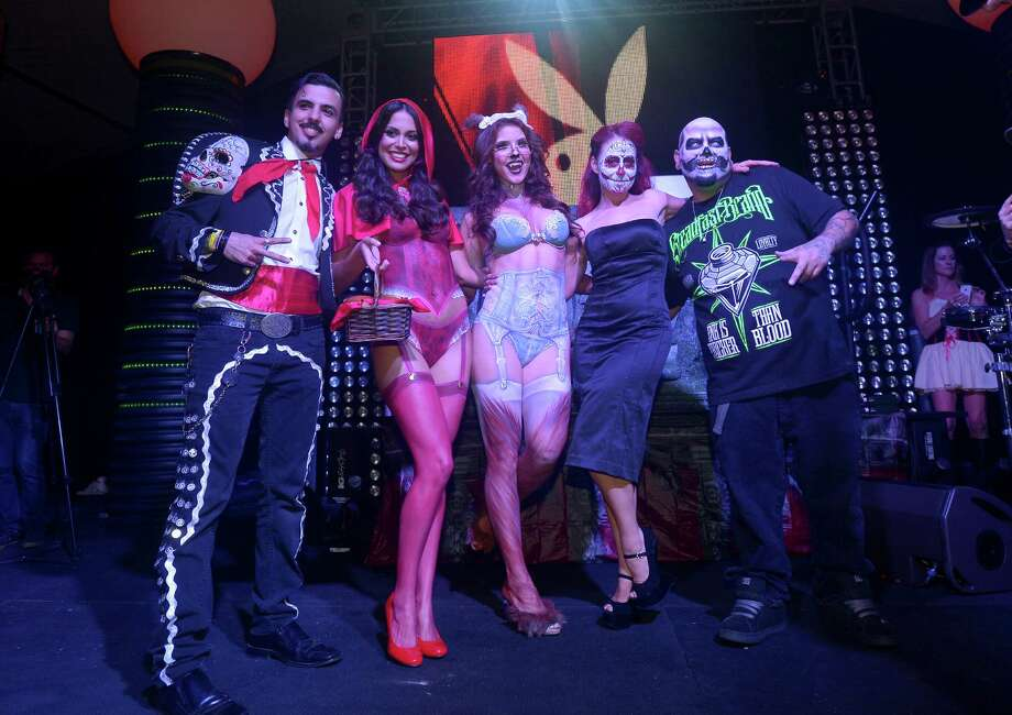 Playmate of the Year Raquel Pomplun (2nd L), Playmate Amanda Cerny (C) and the cast of Syfy's Naked Vegas pose onstage at Playboy Mansion's annual Halloween bash on October 26, 2013 in Holmby Hills, California. Photo: Charley Gallay, Getty Images / 2013 Getty Images