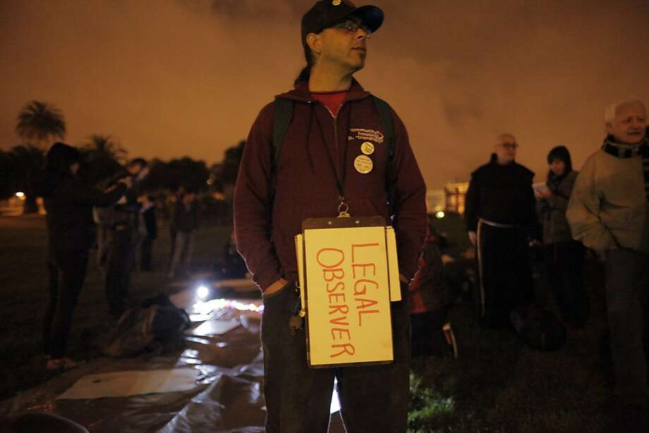 Elihu Hernandez keeps an eye out for police at Dolores Park on Monday night, October 28, 2013 in San Francisco, Calif. The Harvey Milk LGBT Democratic Club hosted a sleep in to protest Supervisor Scott Wiener's proposed ordinance for city-wide park closure hours, which they believe targets the homeless and especially LGBT homeless youth. Photo: Carlos Avila Gonzalez, The Chronicle