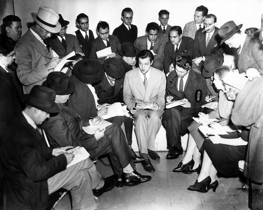 American actor, producer and director Orson Welles  speaking to a room full of reporters after his radio dramatization of the H G Wells novel, 'War of the Worlds' in 1938. Photo: Hulton Archive, Getty Images / Archive Photos