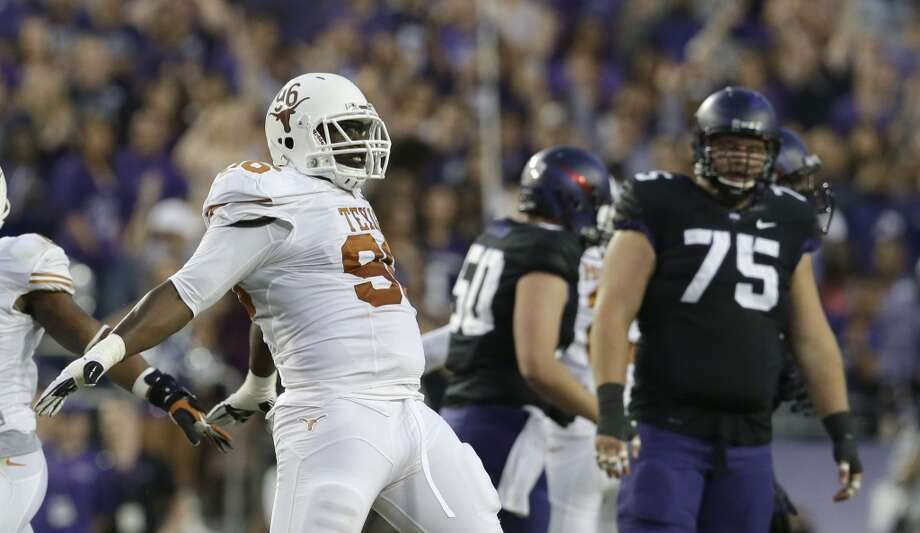 Texas 30, TCU 7Record: 5-2Texas defensive tackle Chris Whaley celebrates after TCU missed a field goal during the first half. Photo: LM Otero, Associated Press