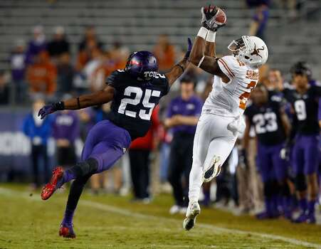 Kendall Sanders #2 of the Texas Longhorns pulls in a pass against Kevin White #25 of the TCU Horned Frogs in the third quarter. Photo: Tom Pennington, Getty Images