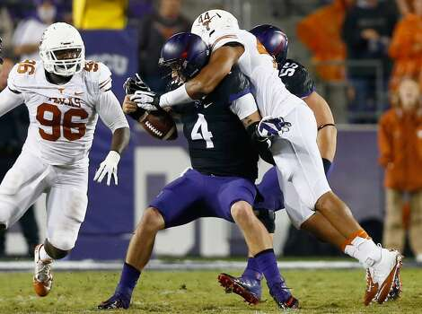 Casey Pachall #4 of the TCU Horned Frogs is sacked by Jackson Jeffcoat #44 of the Texas Longhorns as Chris Whaley #96 of the Texas Longhorns assists in the third quarter. Photo: Tom Pennington, Getty Images