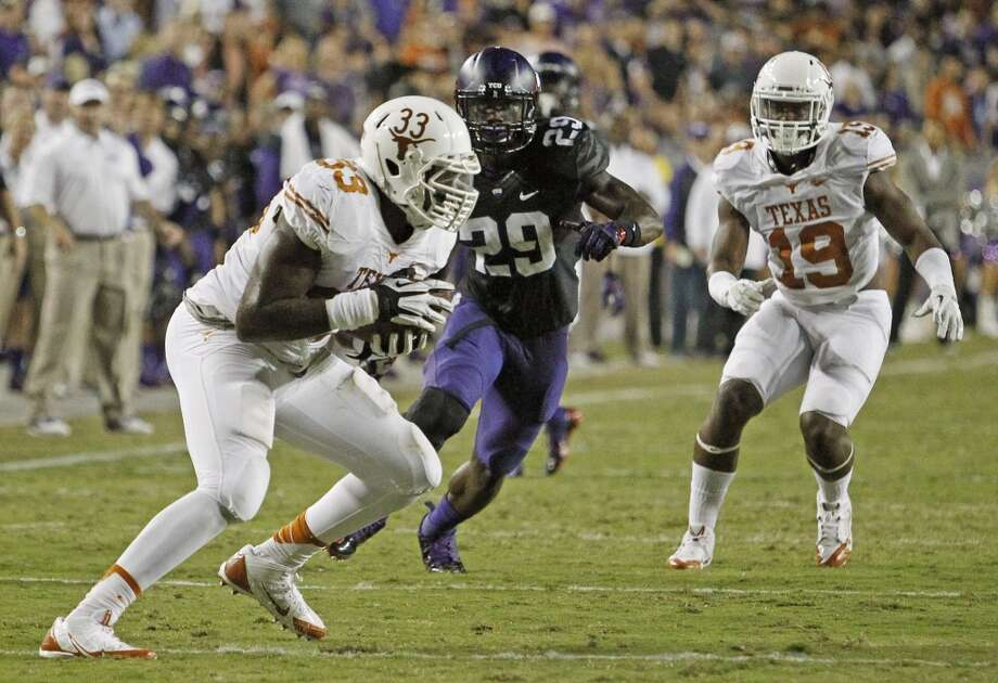 Texas linebacker Steve Edmond (33) picks off Texas Christian quarterback Casey Pachall in the second quarter Photo: Paul Moseley, MCT