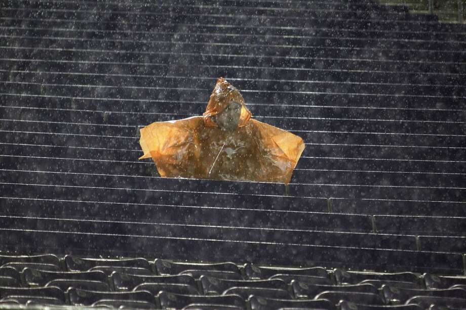 A lone, hardy Texas fan toughs it out during the second-quarter rain delay. Photo: Paul Moseley, MCT