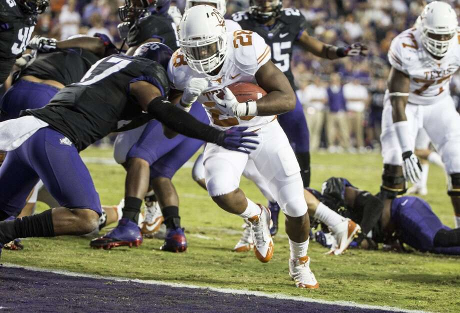 Texas' Malcolm Brown runs into the end zone with a 3-yard touchdown run in the first half. Photo: Ricardo B. Brazziell, MCT