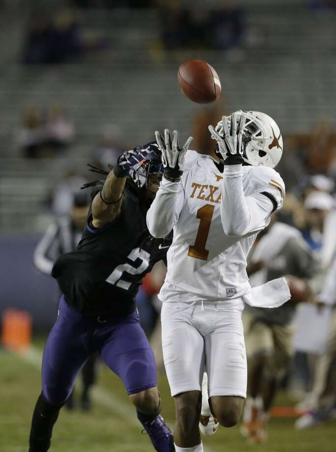 Wide receiver Mike Davis (1) catches a pass against TCU cornerback Jason Verrett (2) during the second half. Photo: LM Otero, Associated Press