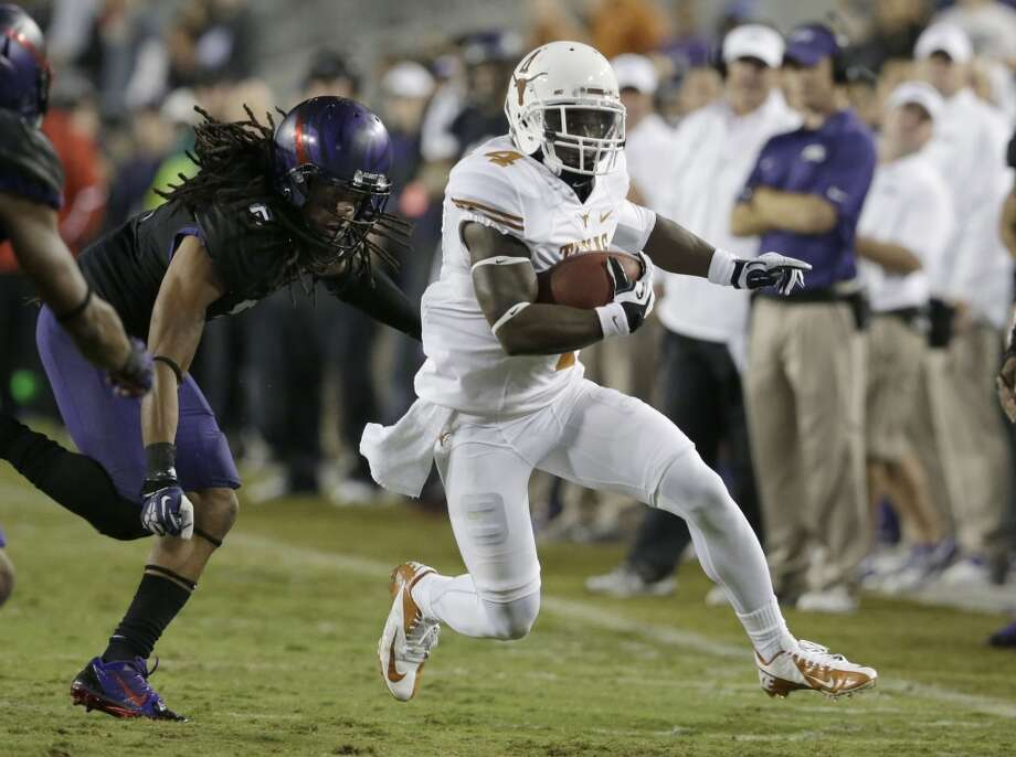 Texas running back Daje Johnson (4) runs agains TCU cornerback Jason Verrett (2)during the second half. Photo: LM Otero, Associated Press