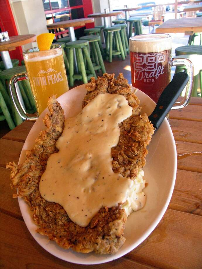 Chicken fried steak that is as big as your face at Twin Peaks, 20931 Gulf Freeway in Webster.   Photo: Jordan Graber, For The Chronicle