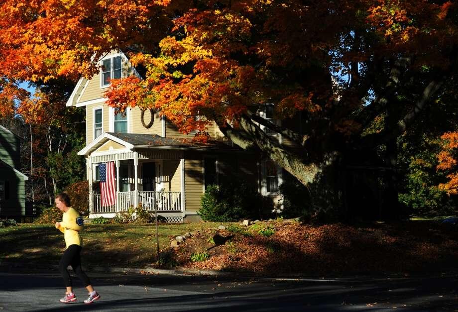 Fall foliage at its peak on Fairfield Woods Road in Fairfield, Conn. on Sunday, Oct 20, 2013. Staff photo/Cathy Zuraw Photo: Cathy Zuraw