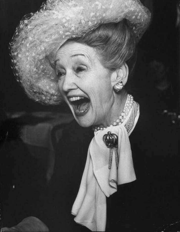 Columnist, Hedda Hopper, wearing trade-mark hat, during her coast-to-coast tour promoting her new book, The Whole Truth and Nothing But, in Chock-full-o-Nuts restaurant.  (Photo by Bob Gomel//Time Life Pictures/Getty Images) Photo: Bob Gomel, Time & Life Pictures/Getty Image / Bob Gomel