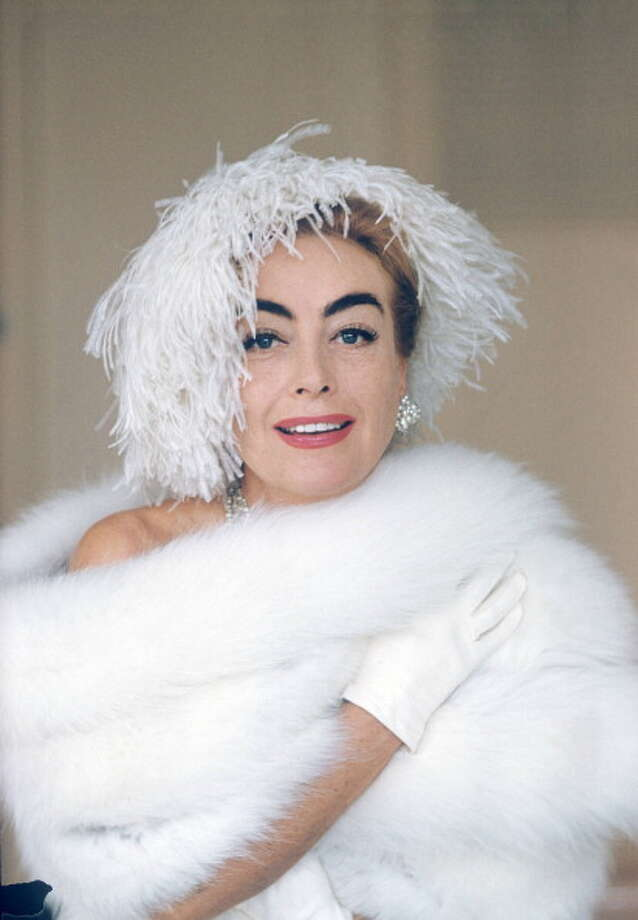 Joan Crawford (1905-1977), US actress, wearing white ostrich feather hat, posing with a white fur wrap, circa 1960.  Mean Mommy. Photo: Silver Screen Collection, Getty Images / 2011 Silver Screen Collection