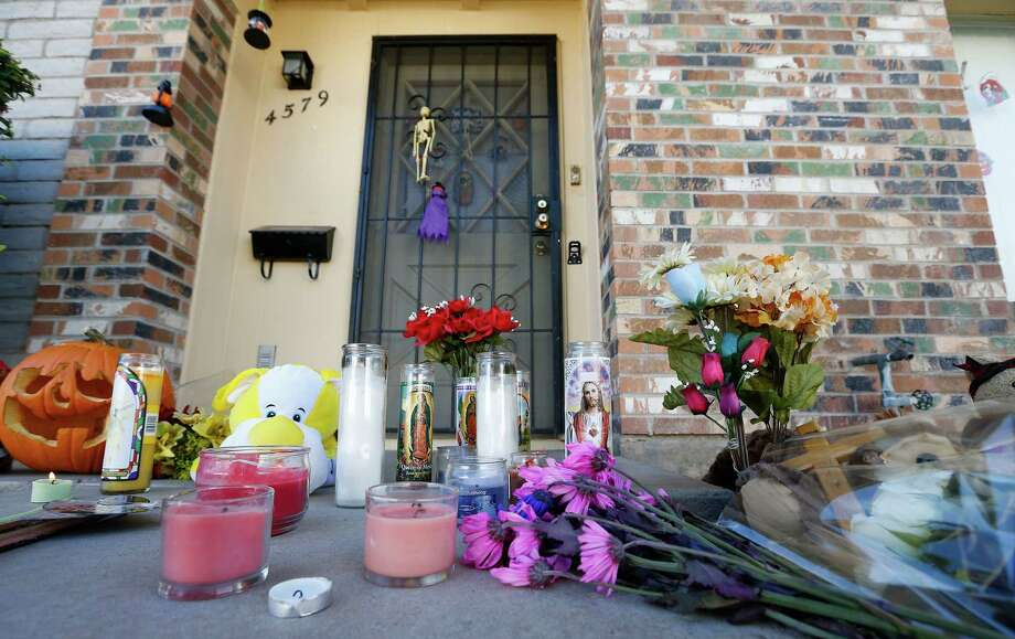 A makeshift memorial has been set up in front of the Moore home on Monday Oct. 28, 2013, in Phoenix, to remember the four shooting victims.  Police say loud barking dogs might have led to 56-year-old Michael Guzzo, to kill four of his neighbors and the neighbors' two dogs before turning the gun on himself, and dying.  The victims were identified as Bruce Moore, 66; his daughter, Renee Moore, 36; her husband, Michael Moore, 42, who took his wife's name; and Renee's son, Shannon Moore, 17. Photo: Ross D. Franklin, AP / AP