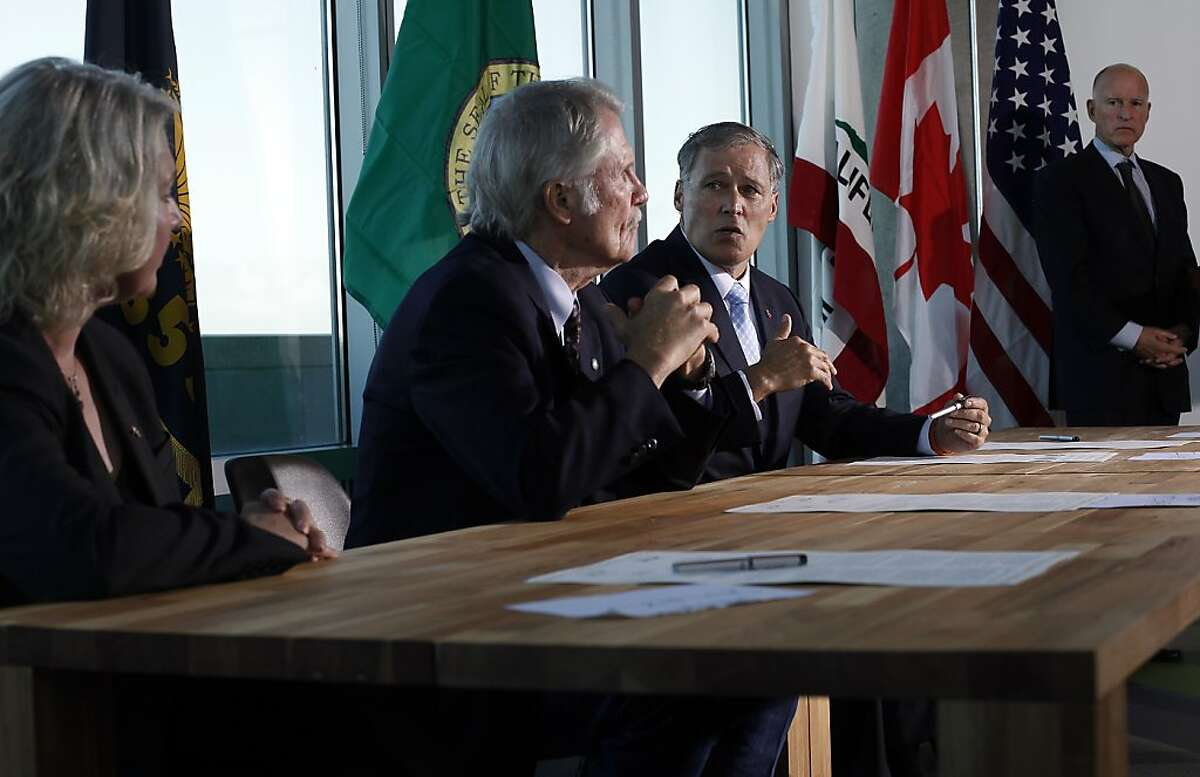 Washington Governor Jay Inslee, right, answers a question after he and Oregon Governor John Kitzhaber, left, the British Columbia Minister of Environment Mary Polak, far left, and California Governor Jerry Brown, right, signed a climate change agreement in San Francisco, Calif., on Monday, October 28, 2013.