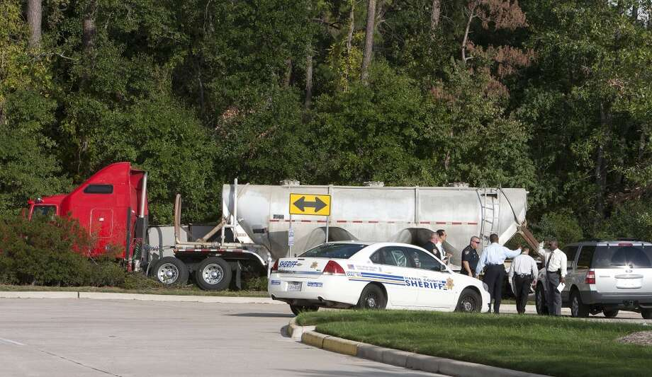 Officers from multiple agencies work at the scene of a shooting in which Drug Enforcement Administration informant Lawrence Chapa, who was posing as a truck driver to infiltrate the drug world, was shot to death at Hollister near Champions Walk Lane Monday, Nov. 21, 2011, in Houston.  ( James Nielsen / Chronicle ) Photo: James Nielsen, Houston Chronicle