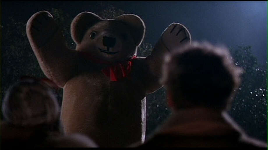 """Teddy Bears:  In the movie """"Dolls"""" (1987) a beloved teddy bear is tossed into the bushes, only to grow into a werewolf-like monster and gnaw the arm off the step mother who had discarded it. Lesson – don't throw away your child's beloved toys. Photo: Handout, Empire Pictures"""