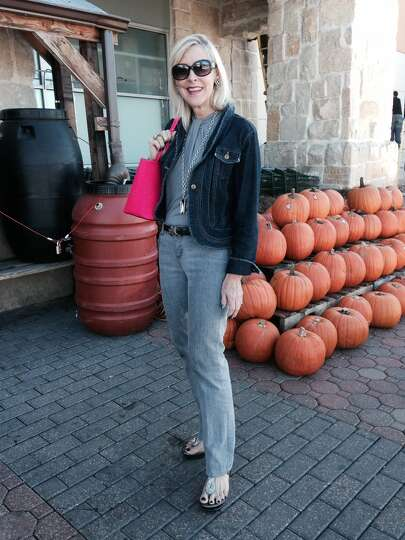 Gail Gifford is Halloween chic in coordinating shades of gray. Her cropped denim inky blue ja