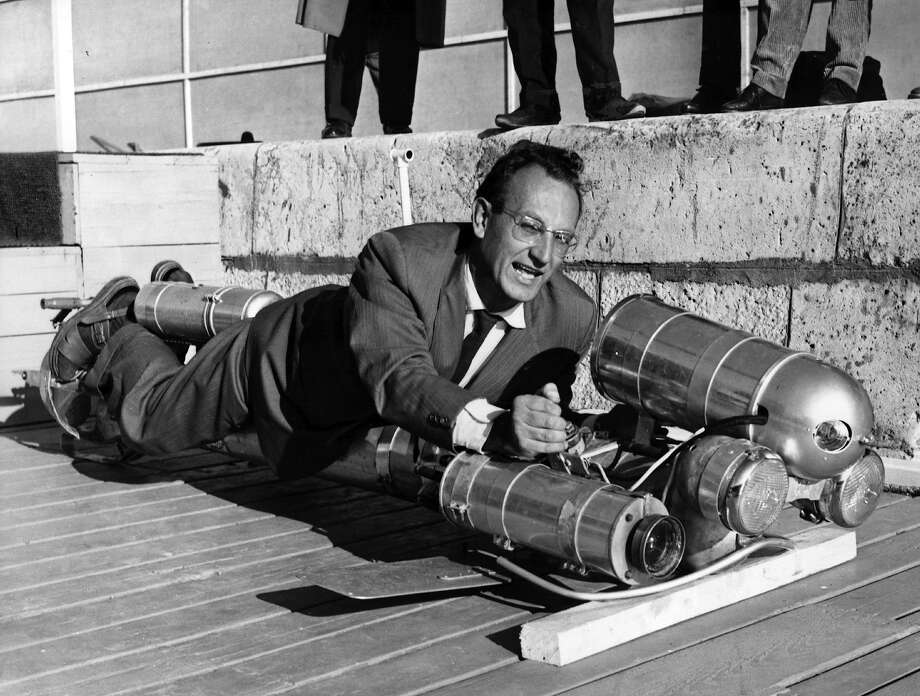 Human torpedo, 1958Honestly, the most disturbing thing about this photo is that this guy is wearing sandals with black socks under a suit. Photo: Keystone, Getty Images / Hulton Archive