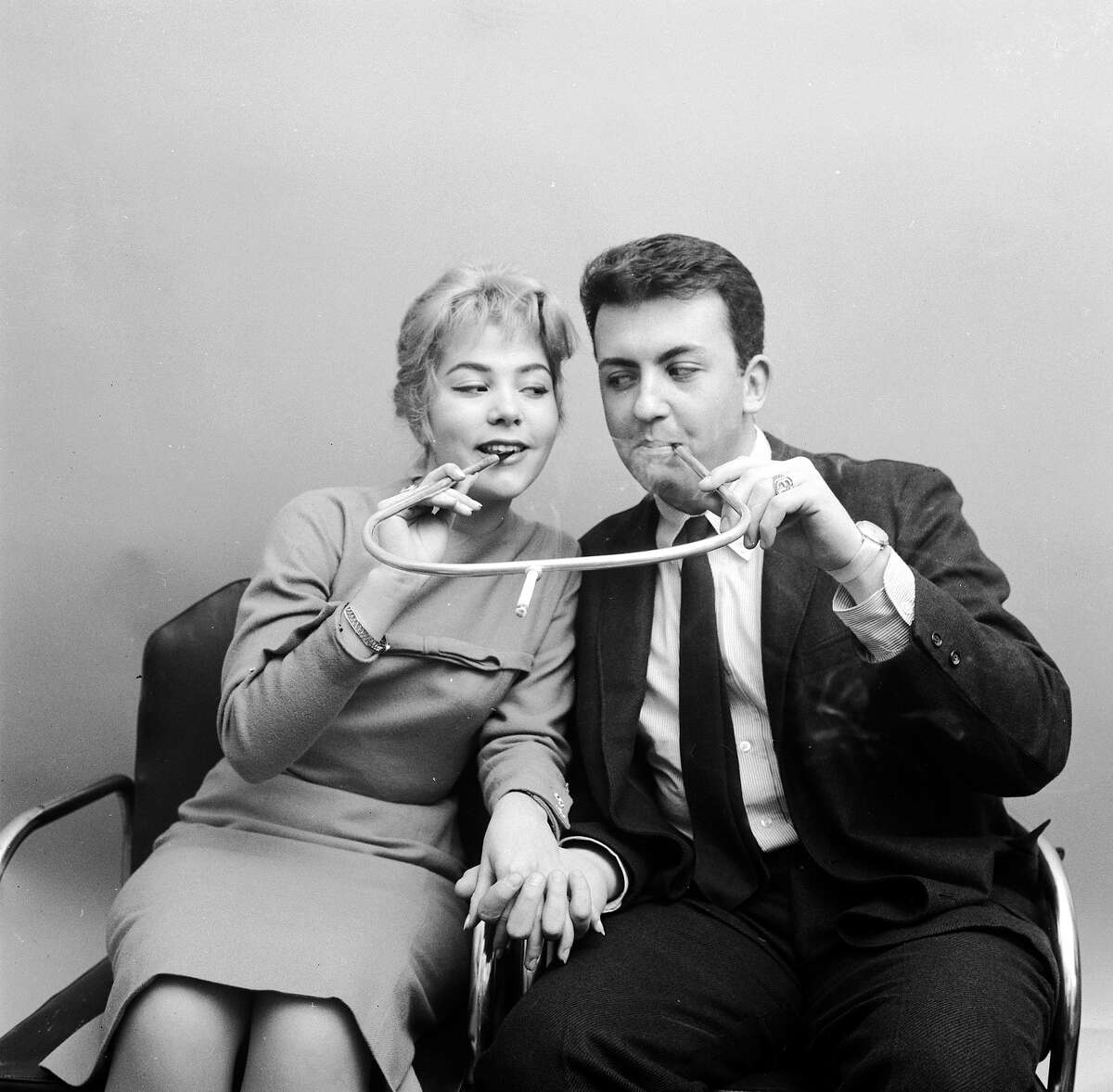 Cigarette holder made for two, 1955 Half the nicotine, twice the intimacy. But come on.