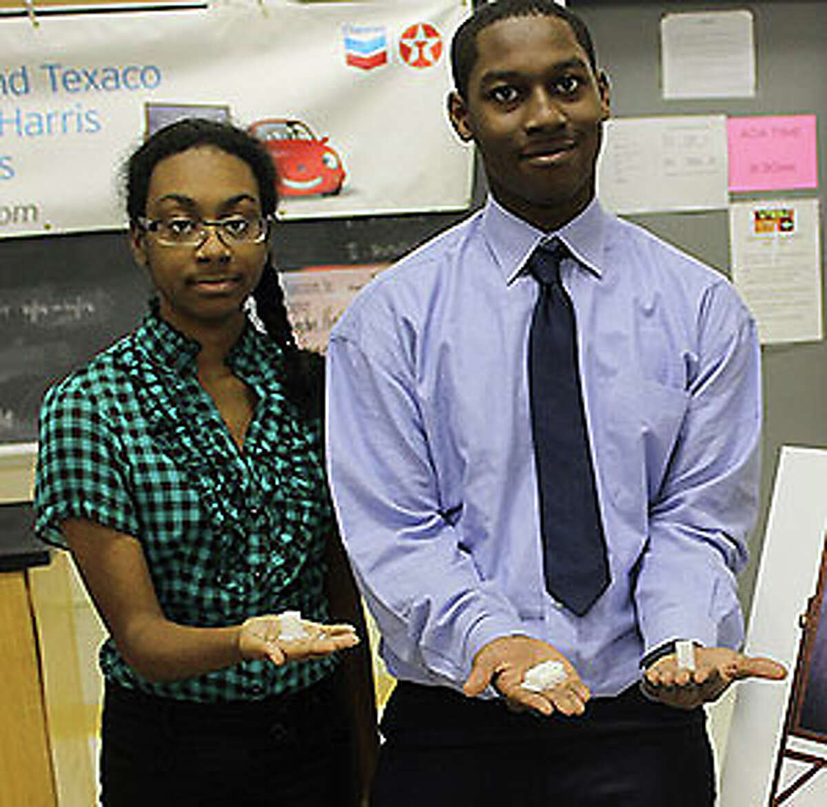 Students in Nghia Le's engineering classes display three-dimensional objects they created with equipment purchased through Chevron's Fuel Your School program.