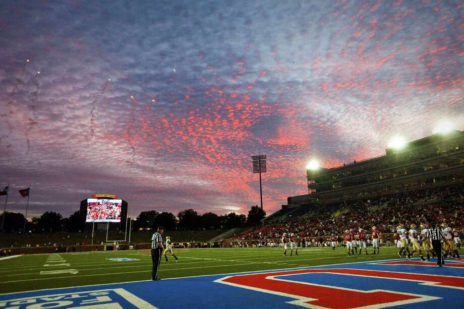 Fireworks explode over Gerald J. Ford Stadium after a SMU touchdown at sunset during the NCAA football game between the Southern Methodist University Mustangs and the Navy Midshipmen on Saturday, November 12, 2011. Navy beat SMU 24-17. (Patrick T. Fallon/The Dallas Morning News) Photo: Patrick T. Fallon, Staff Photographer / 10011379A
