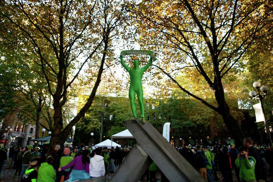 """Sean Harwin shows off his """"greenman"""" suit during the traditional """"March to the Match"""" rally before the the Sounders final game of the season vs. LA Galaxy on Sunday, Oct. 27, 2013 at CenturyLink Field in Seattle. A crowd of 66,216 fans watched the Sounders tie a 1-1 match. Photo: SOFIA JARAMILLO, SEATTLEPI.COM / SEATTLEPI.COM"""