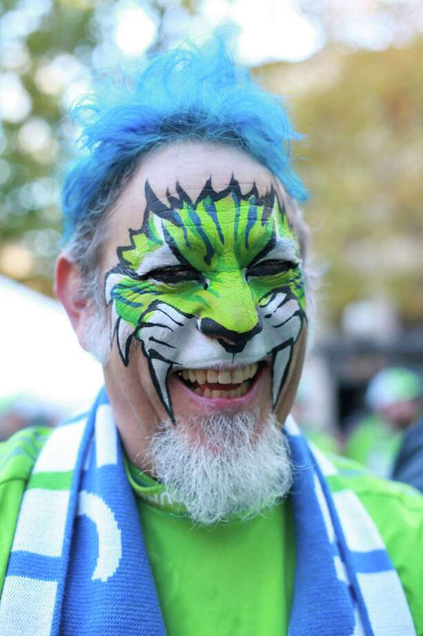 "Luis Venitl shows off his face paint during the traditional ""March to the Match"" rally before the the Sounders final game of the season vs. LA Galaxy on Sunday, Oct. 27, 2013 at CenturyLink Field in Seattle. A crowd of 66,216 fans watched the Sounders tie a 1-1 match. Photo: SOFIA JARAMILLO, SEATTLEPI.COM / SEATTLEPI.COM"