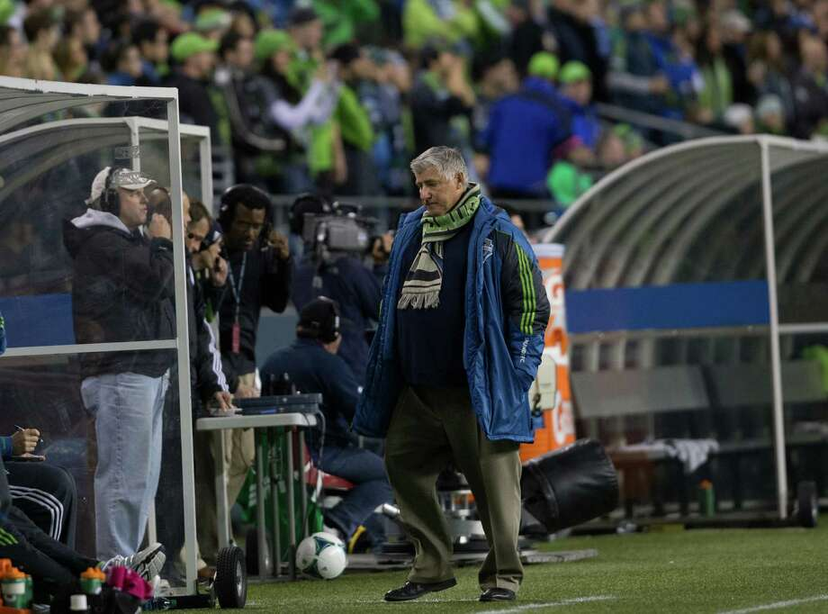 Seattle Sounders coach Sigi Schmid reacts after LA Galaxy scored a goal during the second half of the Seattle Sounders final game of the season vs. LA Galaxy on Sunday, Oct. 27, 2013 at CenturyLink Field in Seattle. A crowd of 66,216 fans watched the Sounders tie a 1-1 match. Photo: SOFIA JARAMILLO, SEATTLEPI.COM / SEATTLEPI.COM