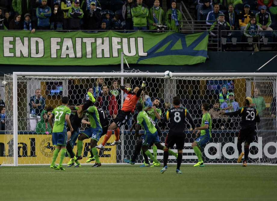 LA Galaxy goalie Carlo Cudicini jumps to block the ball during the second half of the Seattle Sounders final game of the season vs. LA Galaxy on Sunday, Oct. 27, 2013 at CenturyLink Field in Seattle. A crowd of 66,216 fans watched the Sounders tie a 1-1 match. Photo: SOFIA JARAMILLO, SEATTLEPI.COM / SEATTLEPI.COM
