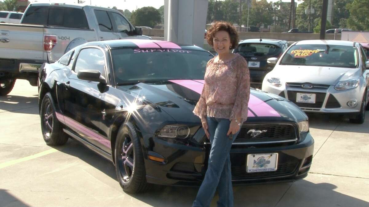 Gabriela Spellman, a breast cancer survivor since 2009, was surprised with the Breast Cancer Awareness Ford Mustang created by Randall Reed's Planet Ford in Humble, by her husband David, after they saw it at the Susan Komen Race for the Cure.