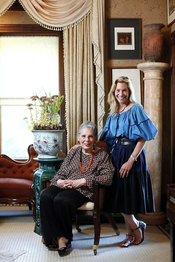 Vintner Audrey Sterling (left), who has passed along some of her couture gown collection to daughter Joy, might donate part of it to a museum. Photo: Sarah Rice, Special To The Chronicle