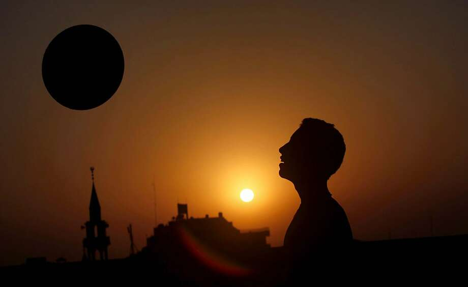 A Palestinian youth practices his football skills as the sun sets in Gaza City. Photo: Hatem Moussa, Associated Press
