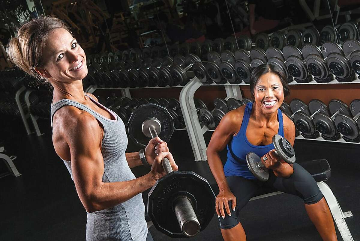 Curling irons: Workout buddies Julie Lee (left) and Sommana Levering - winners of the Open and Masters divisions, respectively, at the Iron Mountain Physique Championships - train in Pasco, Wash. Lee, who has been competing in bodybuilding for seven years, recruited Levering to the sport about a year ago.