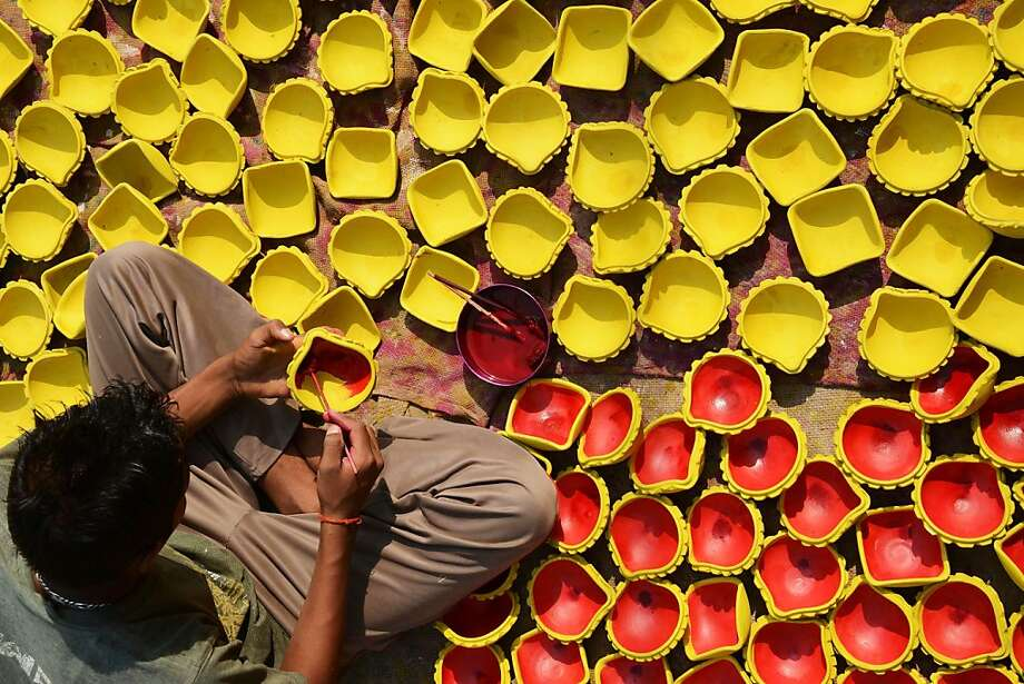 An Indian craftsman paints clay diyas (earthen lamps) ahead of the Hindu festival of Diwali in Amritsar. Diwali, celebrated this year Nov. 3, marks the victory of good over evil. Photo: Narinder Nanu, AFP/Getty Images
