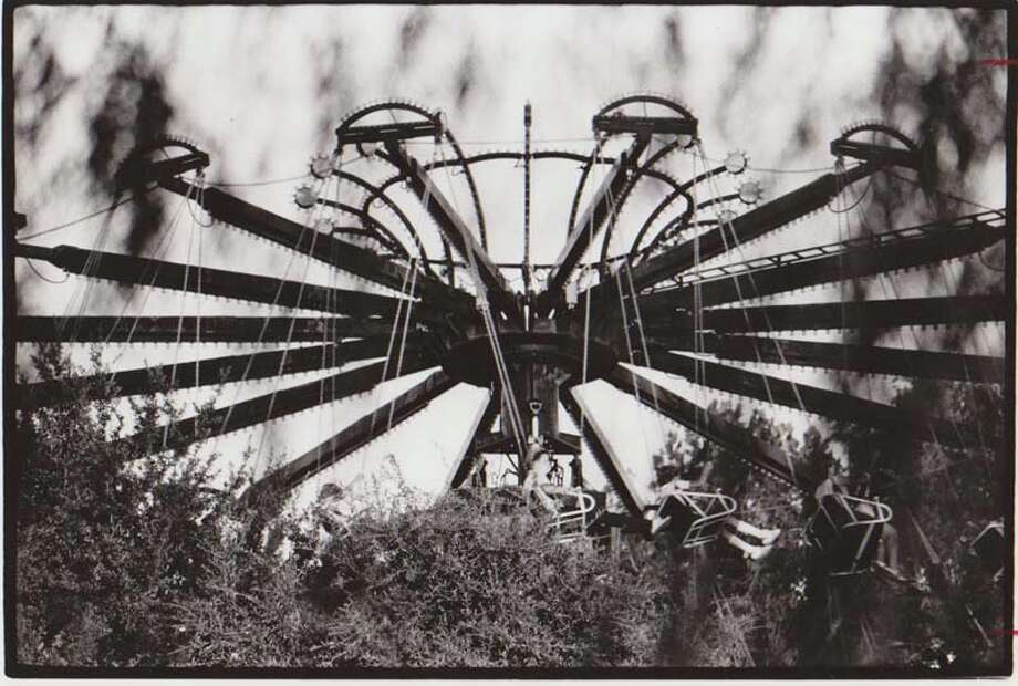 Pictured is AstroWorld's flying chair ride on Aug. 21, 1978.  Photo: Buster Dean, Houston Chronicle