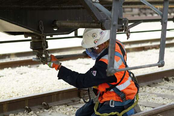 A Plains All American Pipeline employee works on a rail car at a terminal  in St. James, La.