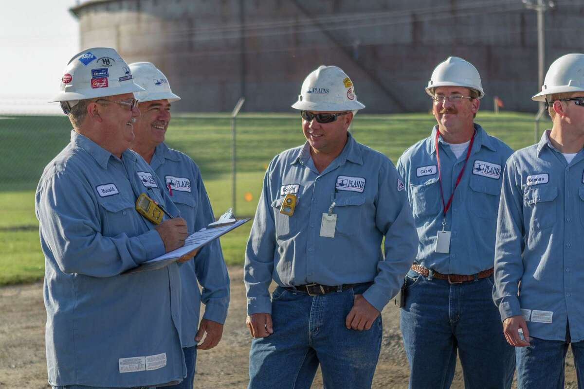 Workers for Plains All American Pipeline meet at a terminal in Cushing, Okla. Plains ranked No. 3 on the list of the best large companies to work for.