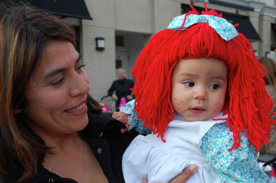 Matilda Irigoyen of Westport made her 7-month-old daughter Eloise's Raggedy Ann costume by hand for Tuesday's Halloween parade in downtown Westport. Photo: Jarret Liotta / Westport News contributed