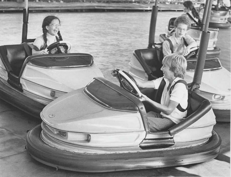 Children enjoy the bumper cars in AstroWorld on July 9, 1979. Photo: Timothy Bullard, Houston Chronicle