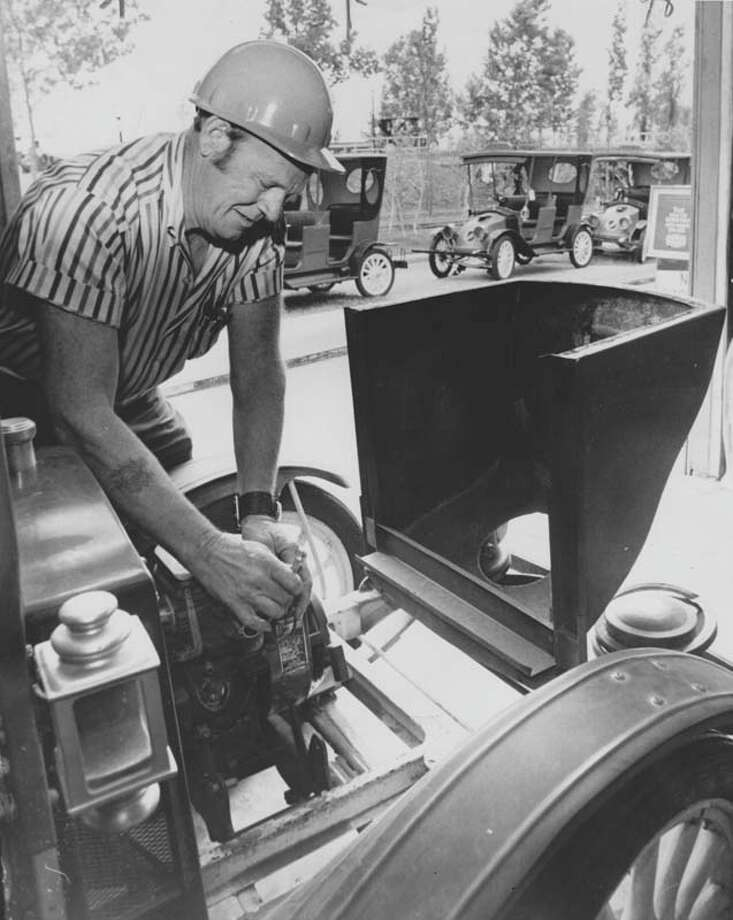 Mechanic Tommy Hull is pictured in May 1972 performing maintenance on one of the rides. Photo: Tom Colburn, Houston Chronicle