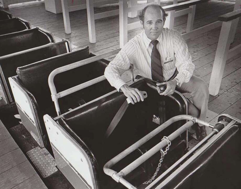 AstroWorld executive Bill Crandall displays the then-new safety devices on the Texas Cyclone in 1976. Before they were installed, the park had complaints of people standing up during the ride. Also, it was just unsafe. Photo: Joseph Deering, Houston Chronicle