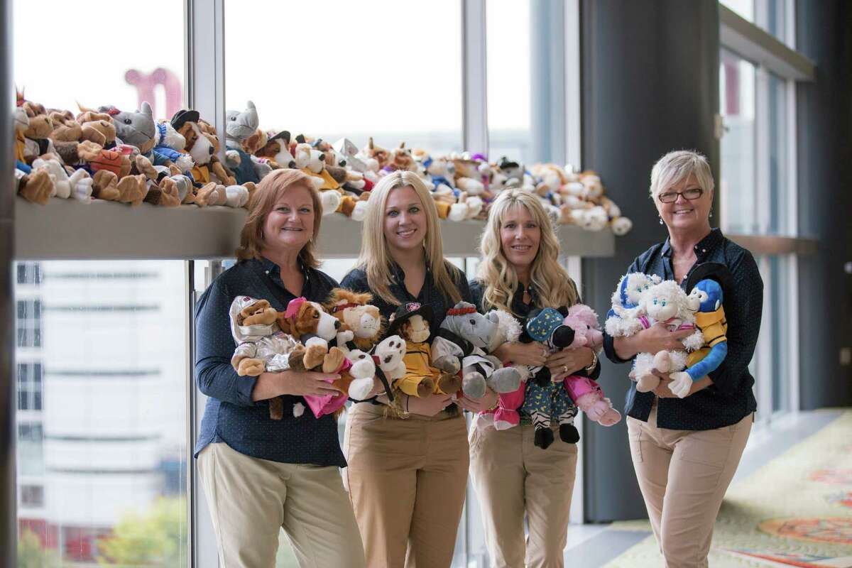 Insperity employees Laurie Hiett, left, Kelsie Thaler, Corinn Price and Lynette White take part in Insperity's fall campaign stuffed animal kickoff event for Children's Memorial Hermann Hospital.