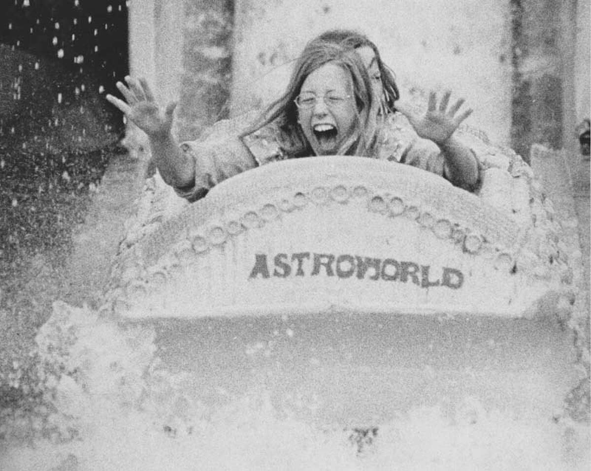 A rider gets splashed on AstroWorld's Bamboo Shoot ride on June 1, 1973.